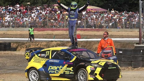 Derek Tohill celebrating after winning his 2013 ERC Touring Car series event