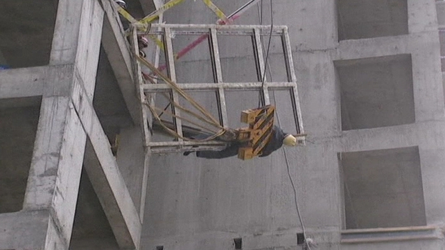 The worker was left dangling in the air after a frame came loose