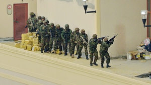 Kenyan soldiers move in formation to clear the top floor balcony and interior of the Westgate Mall in Nairobi