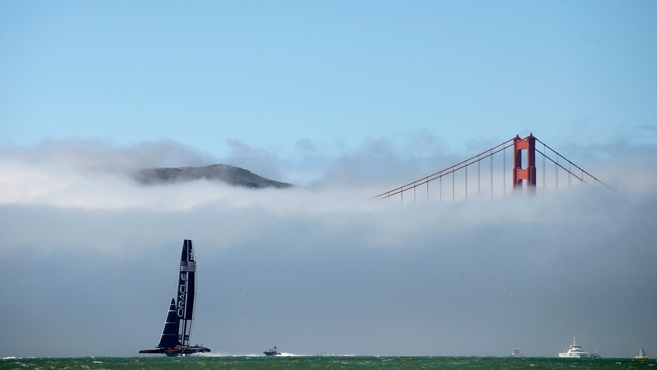 Oracle Team USA warms up near the Golden Gate Bridge before competing in San Francisco, California