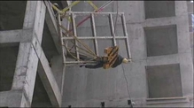 Construction worker lifted to safety