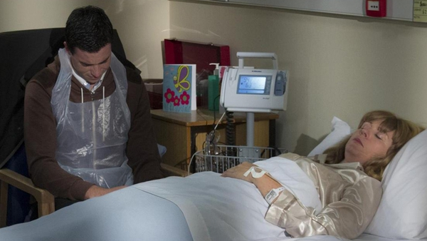 Cathal waits by Bernie's hospital bed