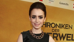 Lily Collins is the daughter of British singer Phil Collins