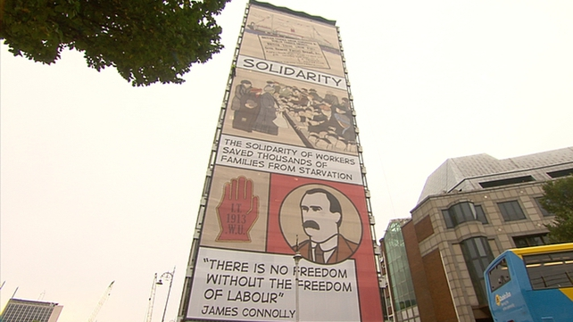 A 50-metre high banner was hung from the western side of the building today