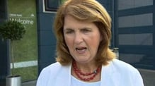 Joan Burton says free travel pass is 'safe'