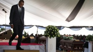 President Uhuru Kenyatta attends the funerals of some of the victims of the attack