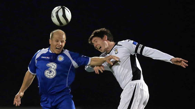 Athlone's Aidan Collins and Paul Quilty of Waterford engage in an aerial confrontation