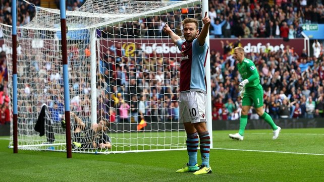 Andreas Weimann celebrates scoring Villa's winner