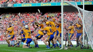 Clare players are unable to stop Cork's goalkeeper Anthony Nash