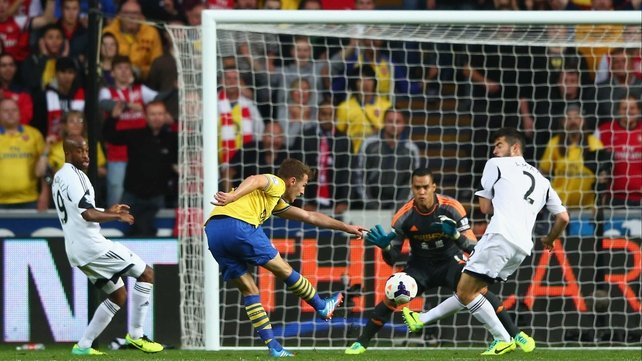 Arsenal's Aaron Ramsey fires past Michel Vorm in the Swansea goal