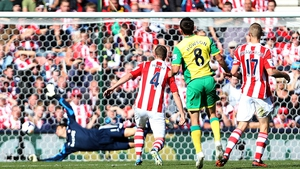 Jonny Howson watches his shot head for the back of the Stoke net