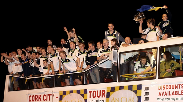 The Clare panel celebrate as their open-top bus arrives at Tim Smythe Park