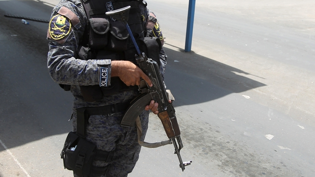 Police were targeted at a checkpoint north of Baghdad