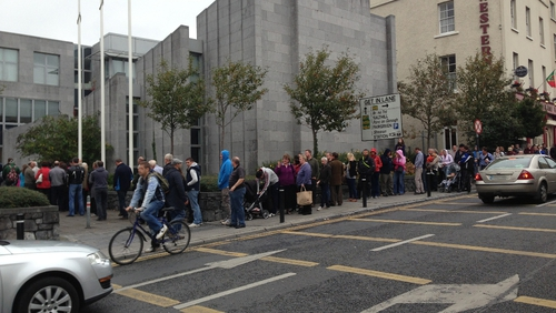 Lengthy queues outside the motor tax office in Galway