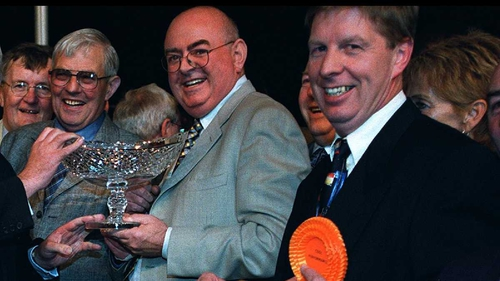 Patsy Byrne (centre) made his mark in the horse racing and greyhound world