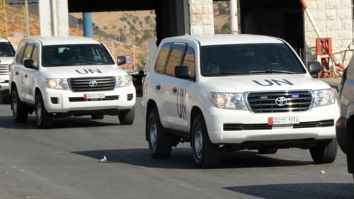 A convoy of United Nations vehicles carrying a team of inspectors is seen following its arrival in Beirut