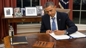 Barack Obama signed a bill to ensure military personnel continue to get paid