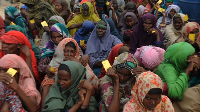 Somali women queue to receive food at a refugee camp in Mogadishu