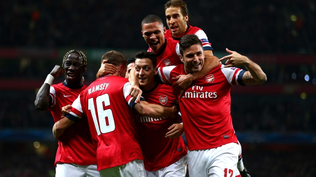 Mesut Ozil opened the scoring as Arsenal continue their impressive run on all fronts