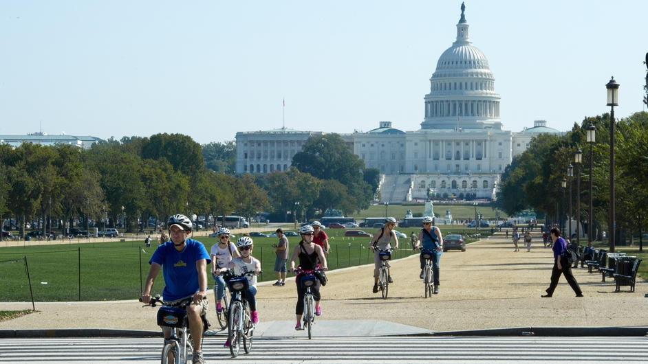 Tourists ride bicycles down the National Mall in Washington, DC after the US Park Police closed off the mall to traffic