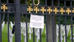 A board informs visitors of the closing of the Suresnes American Cemetery and Memorial in Paris