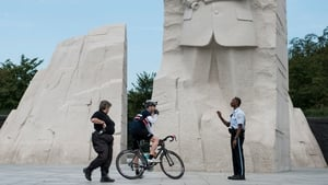 US Park Police Officers speak to a cyclist while closing the Martin Luther King Jr Memorial in Washington