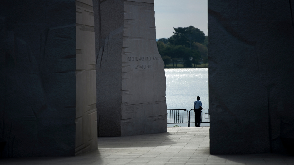 A police officer stands alone at the Martin Luther King Jr Memorial