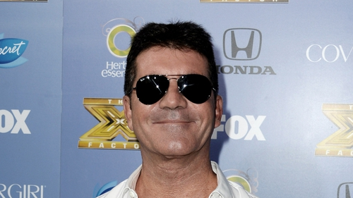 Simon Cowell hints at engagement to Lauren Silverman on Twitter