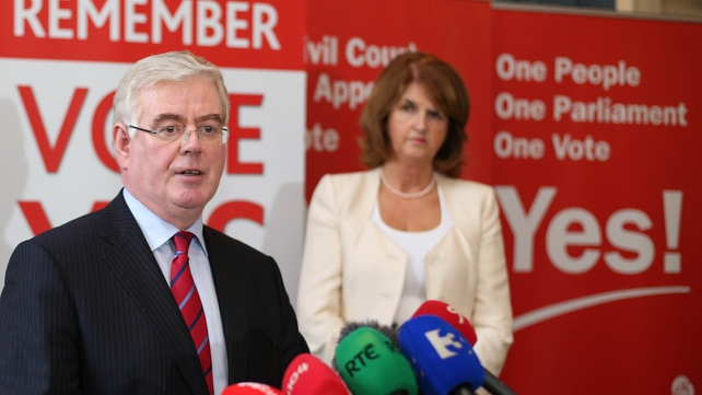 Eamon Gilmore with Joan Burton, who is considered a strong contender for the leadership