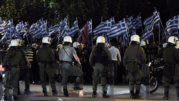 Police monitor a demonstration by Golden Dawn supporters in Athens