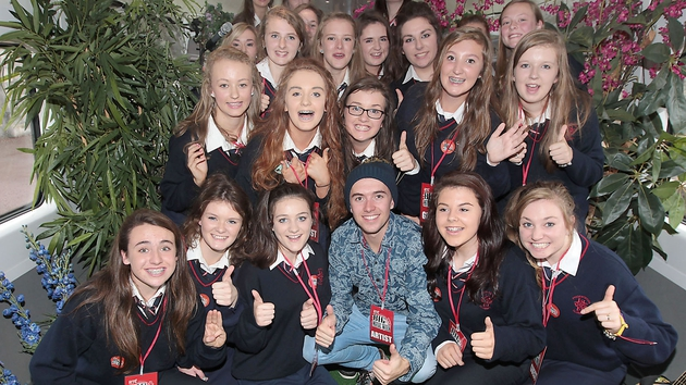 The students pose with Ryan O'Shaughnessy