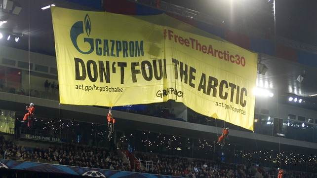 Greenpeace protested over the detention of the 30 members during a recent Champions League game between FC Basel and Schalke 04