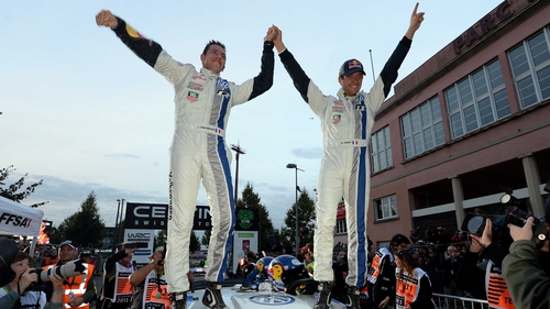 France's Sebastien Ogier (R) and co-driver Julien Ingrassia celebrate their world champion title