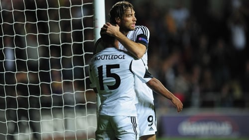 Goalscorer Wayne Routledge receives the congratulations from Michu