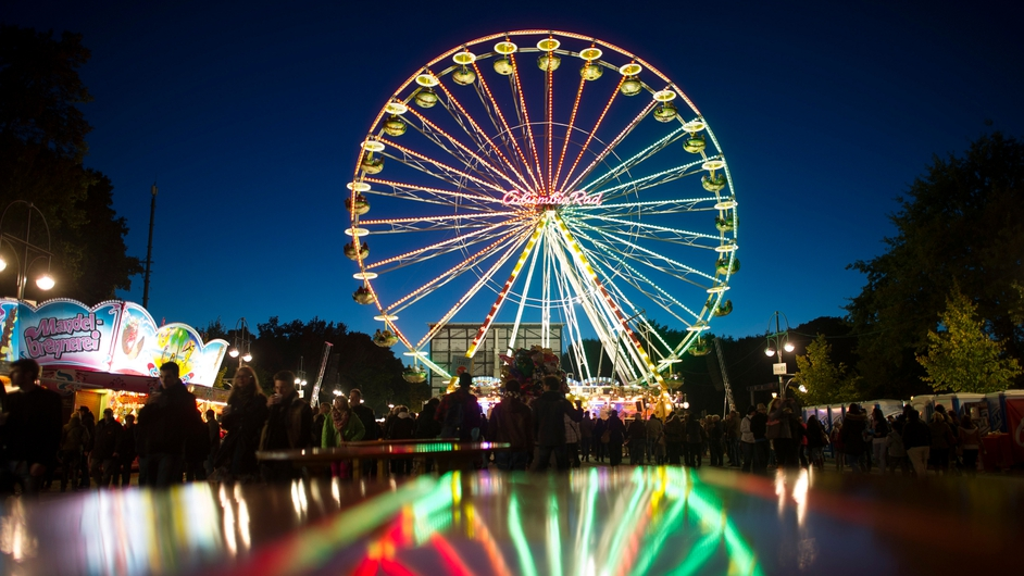 An illuminated ferris wheel on Berlin's Strasse des 17 Juni street, during the annual German Unity Day celebrations