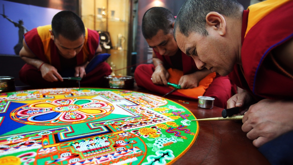 Tibetan Monks from the Tashi Lhunpo Monastery complete a Chenrezig Sand Mandala in Salisbury Cathedral in England