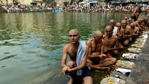 Indian Hindu devotees perform a ritual on the last day for offering prayers to ancestors called 'Pitrupaksh' in Mumbai