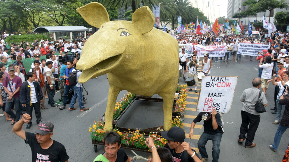 Hundreds of people march to a protest rally in the Philippine financial district in suburban Manila
