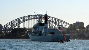 A Chinese warship docks in front of the Sydney Harbour Bridge for a ceremonial fleet review