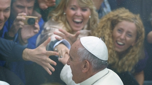 The pope greets the crowd outside the St Francis Basilica as part of his pastoral visit in Assisi