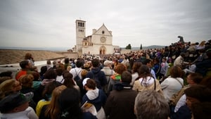 Faithful attend a papal mass outside the St Francis Basilica in Assisi
