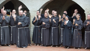 Franciscans wave as Pope Francis leaves San Damiano Sancutary