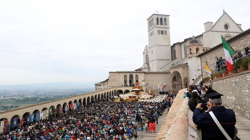 Faithful gather in front of the St Francis Basilica before a mass of Pope Francis as part of his pastoral visit