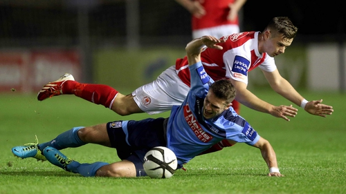 Robbie Creevy of UCD tangles with Greg Bolger of St Pat's