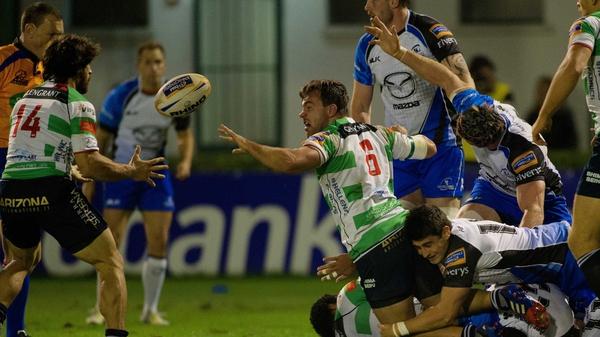 Treviso's Simone Favaro offloads as Fionn Carr tackles