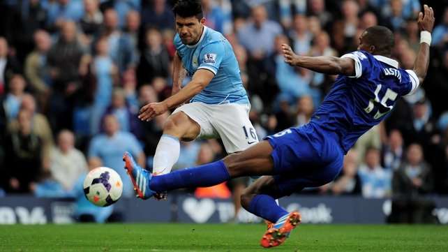 Sergio Aguero of Manchester City shoots past Sylvain Distin of Everton to score his team's second goal