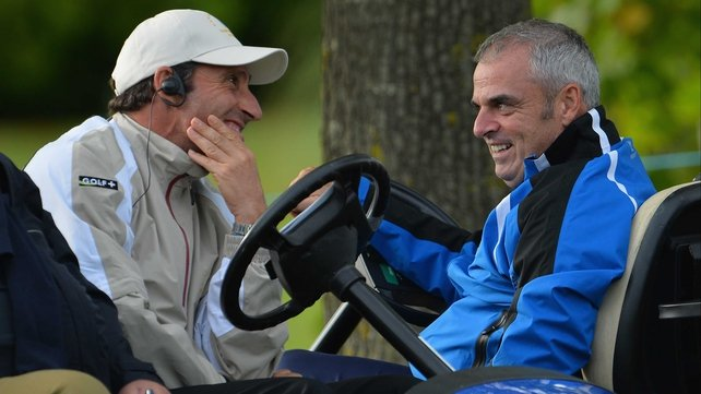 Europe captain Jose Maria Olazabal talks with Ryder Cup captain Paul McGinley during today's foursomes