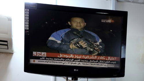 An unidentified gunmen shot two Iraqi television journalists dead as they were filming in the northern city of Mosul