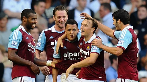 Ravel Morrison (c) is congratulated by his team-mates after scoring West Ham's third goal