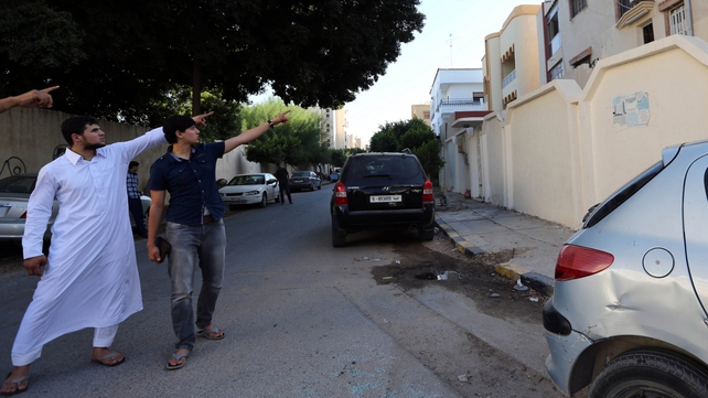 Relatives of Mr Liby point to where he was taken off the Tripoli street by a group of men